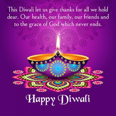 Lamp on rangoli, Diwali wishes.