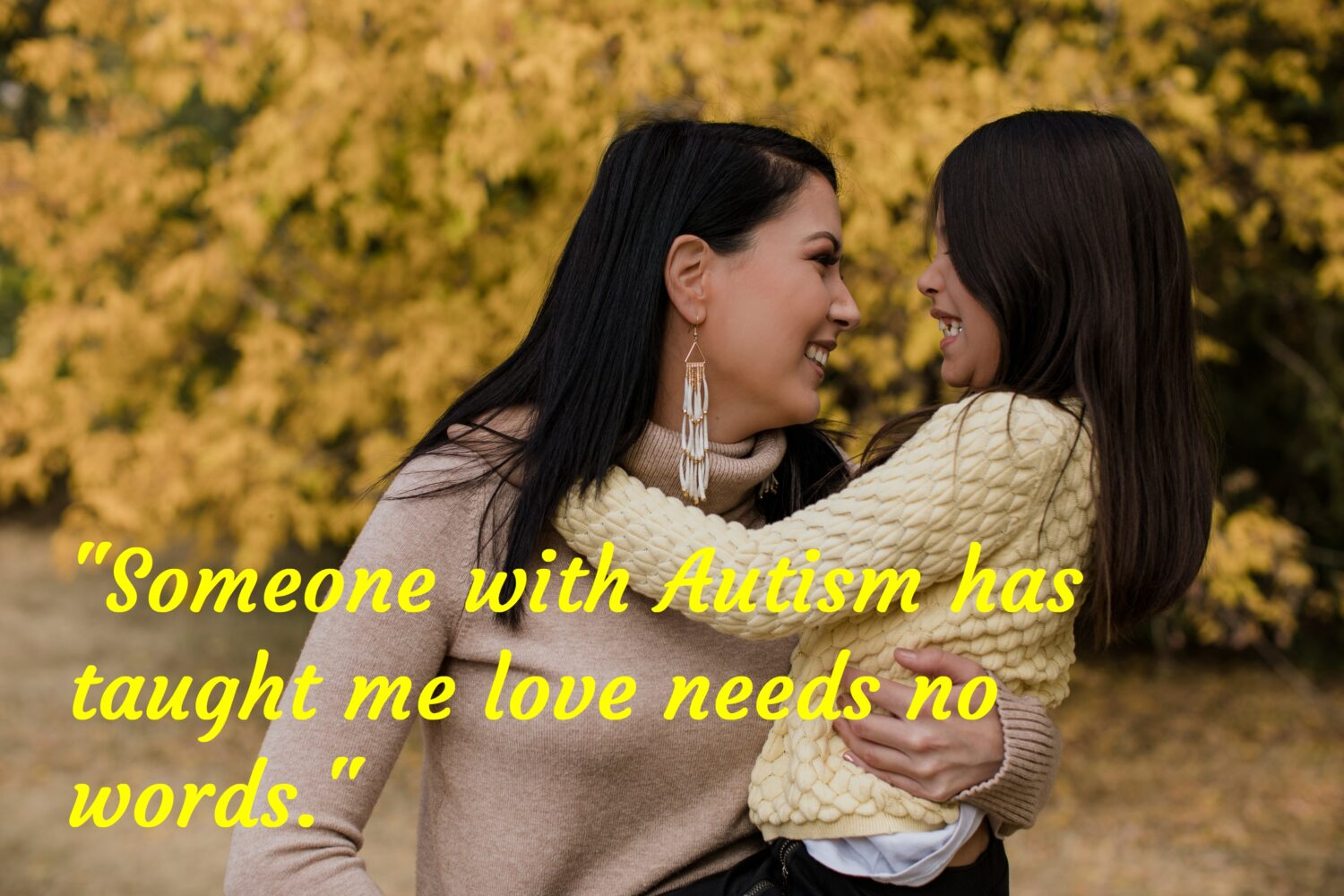 Girl in mothers arm, Autism Awareness Day.